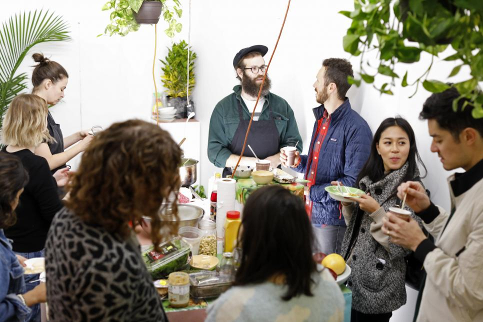 Group of people eating and talking during collaborative project 7 Common by Case Studios