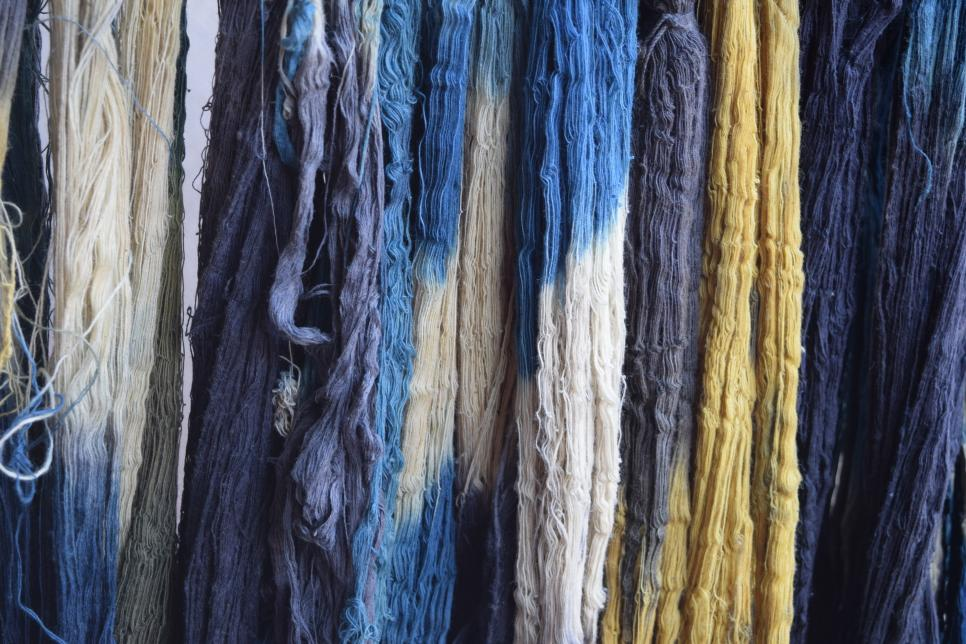 Fabrics hanging to dry after using indigo dye