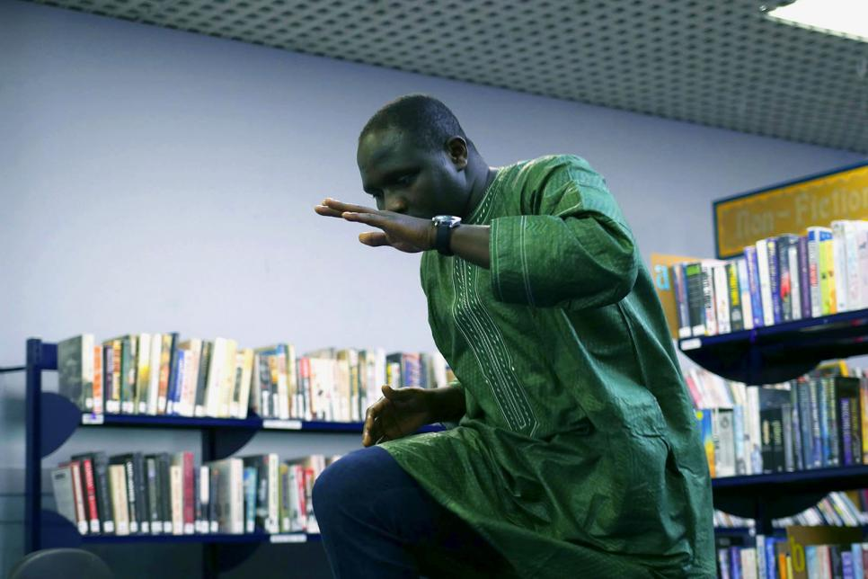 Man performing a dance at the Library