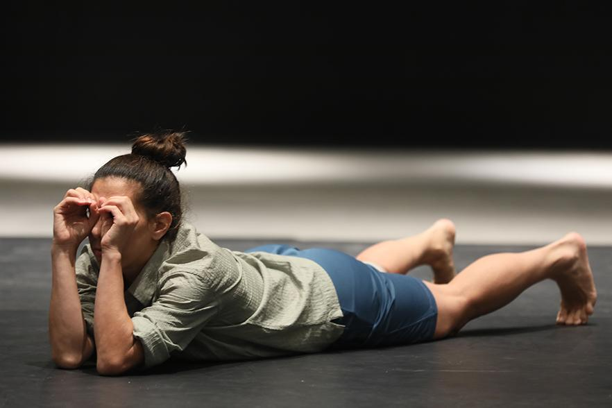 Dancer lying on a stage