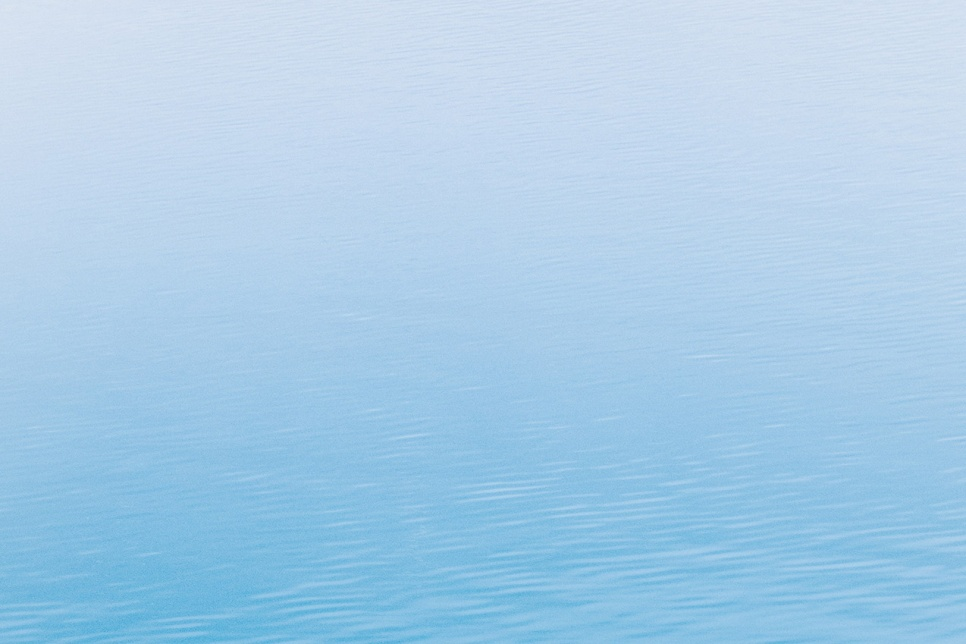 Plain background showing blue water
