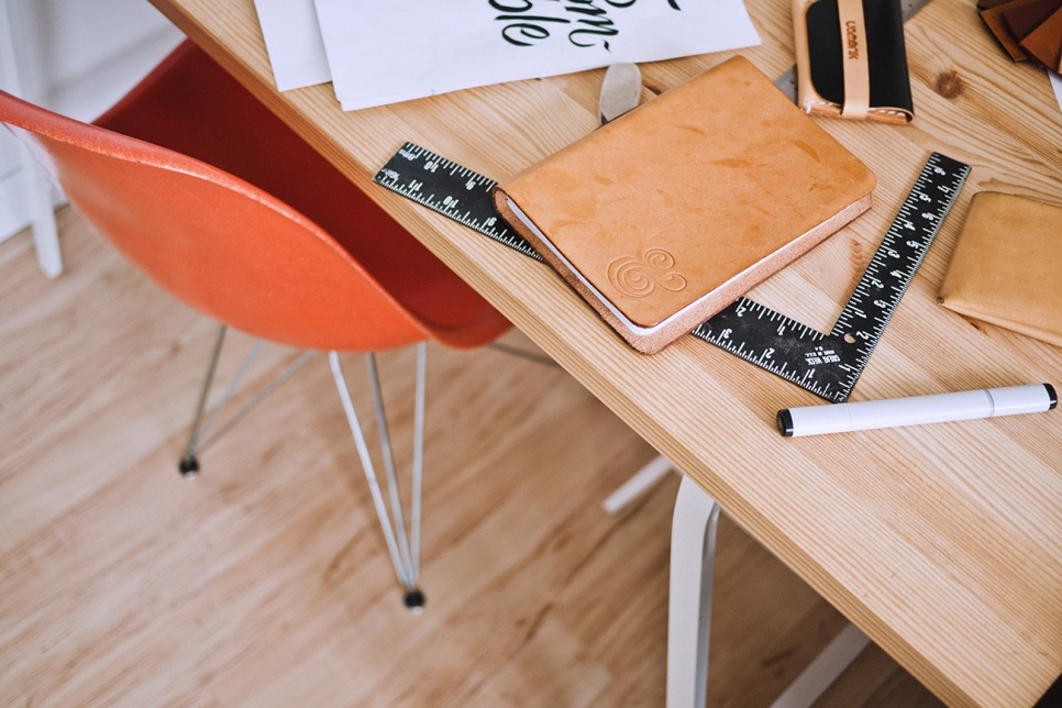Chair and desk showing notepad and pens